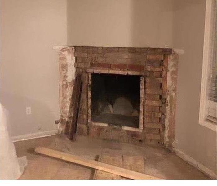 Fire place with bricks falling part