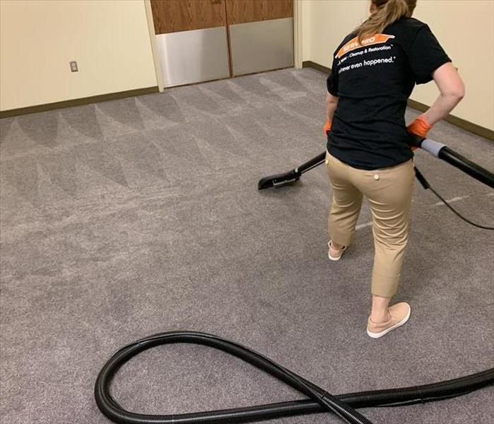crew memeber cleaning carpet